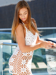 Sabrisse A bares her slender, tight body outdoors.