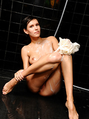 Suzanna A flaunts her wet, sexy body in the shower.