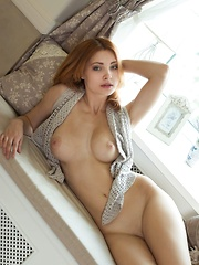 Sultry Kika bares her luscious body and sweet pussy on the sofa.