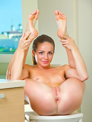 Susana C shows off her flexible, naked body in the bathroom.